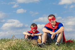 Father and son playing superhero at the day time. People having fun outdoors. Concept of friendly family Royalty Free Stock Photos
