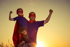 Father and son playing superhero at the sunset time. Stock Photography