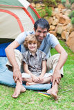 Father and son playing in a tent Royalty Free Stock Image