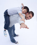 Father and son playing together Stock Photo