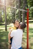 Cute little boy with his father stock photography