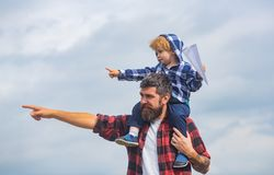Father and son playing together. Cute boy with dad playing outdoor. Childhood. Daddy and child son. Happy kid playing. With paper airplane. Carefree royalty free stock photography