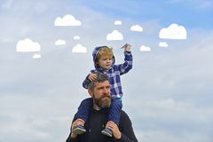Father and son playing together. Father and his son child boy playing outdoors. Childhood. freedom to dream - joyful boy royalty free stock photos