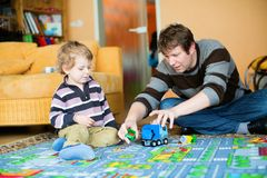 Father and son playing together Stock Image