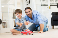 Father and son playing together Stock Images