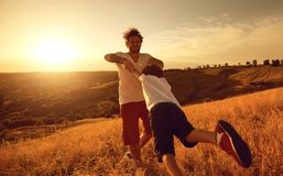 Father and son playing together in nature at sunset. A happy family. Father`s Day stock photos