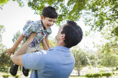 Father and Son Playing Together in the Park Royalty Free Stock Photo