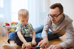 Father and son playing with toy blocks at home Royalty Free Stock Images