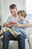 Father and son playing with toy cars Royalty Free Stock Image