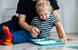 Father and son playing with toys Stock Photo
