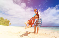 Father and son playing on tropical beach Royalty Free Stock Photos