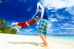 Father and son playing on tropical beach Stock Image