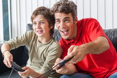 Father and son playing video game. Haapy smile Royalty Free Stock Images