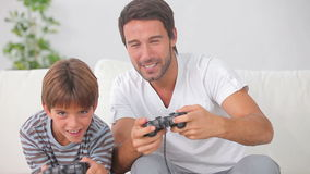 Father and son playing video games together Royalty Free Stock Image