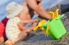 Father and son playng on sandy beach on summer out Royalty Free Stock Images