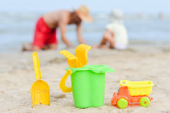Father and son playng on sandy beach Stock Photography