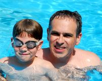 Father son pool. Father and son having fun in a swimming pool Stock Photo