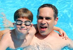Father son pool. Father and son having fun in a swimming pool Royalty Free Stock Photos