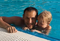 Father and son in the pool Royalty Free Stock Photo