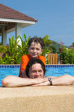 The father and the son in pool Royalty Free Stock Images