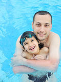 Father and son in pool Royalty Free Stock Image