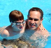 Father son pool Stock Photography
