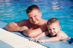 Father and son at the pool board Royalty Free Stock Photography