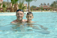 Father with son in pool Stock Image
