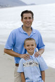 Father and Son Portrait. A father and son together outdoors on the beach stock photo