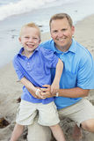 Father and Son Portrait on Beach Stock Images