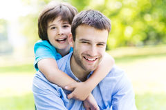 Father and son. Portrait of a happy family outdoors stock image