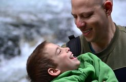 Father and Son. Portrait of father and son laughing and loving; a father holding his son Stock Image