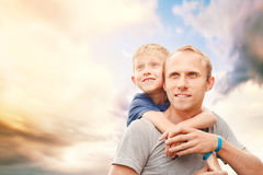 Father with son portrait on the sky background Stock Images