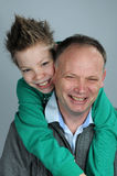 Father and son. Portraits of father and his teenager son Royalty Free Stock Photography