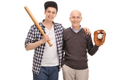 Father and son posing with baseball equipment Royalty Free Stock Images