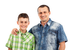 Father and son posing together in studio Stock Photography