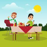 Cartoon father and son preparing for barbecue party in park. Dad fries sausages on grill. Boy fills glass with wine Stock Photo