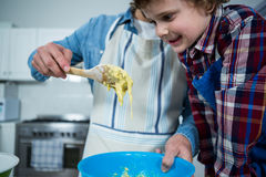 Father and son preparing cupcake Royalty Free Stock Image