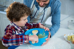 Father and son preparing cupcake Royalty Free Stock Photo