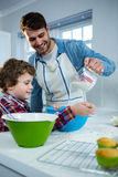 Father and son preparing cupcake Stock Images