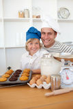 Father and son presenting their muffins Stock Photo