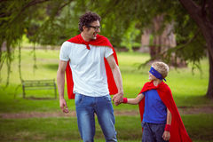 Father and son pretending to be superhero Stock Image