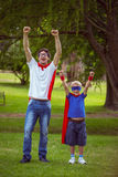 Father and son pretending to be superhero Stock Photography