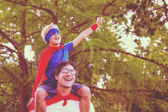 Father and son pretending to be superhero Royalty Free Stock Image