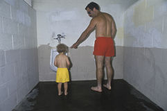 Father and son in public restroom. Stock Images