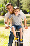 Father son quality time. Happy father and son spending quality time together in the park Stock Photos