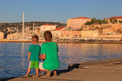 Father and son on the quay in Crete Stock Photos