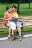 Father and son reading stock image