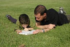 Father and son reading book Royalty Free Stock Images