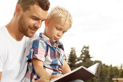 Father and son reading book Royalty Free Stock Photo